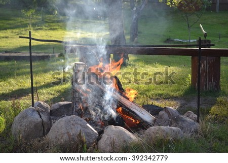 photo cauldron on fire - stock photo