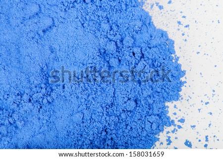 Photo close up of blue paint on white background - stock photo