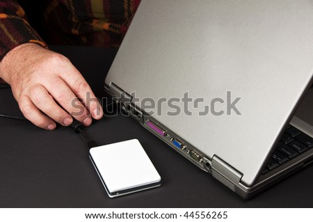 photo close up of laptop and external hard drive - stock photo