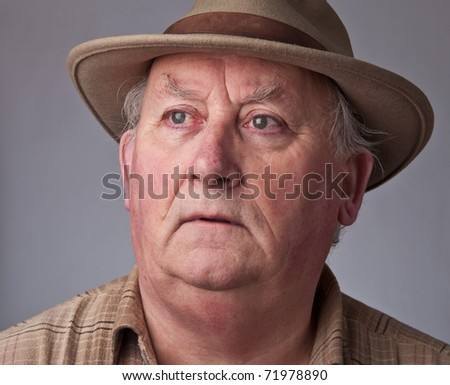 photo close up senior male wearing a hat - stock photo