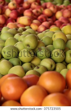 Photo closeup many clean organic natural fresh tasty ripe grape-fruits green red apples crop fruit full of vitamin for healthy eating diet ball form for sale on blurred background, vertical picture - stock photo