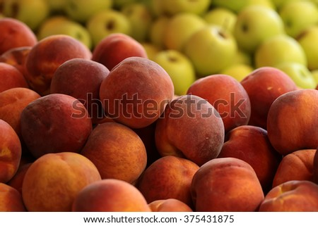 Photo closeup many clean organic natural fresh tasty ripe red yellow peaches velvet skin crop stone fruit full of vitamin for healthy eating for sale on blurred apple background, horizontal picture - stock photo