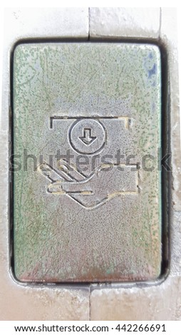 photo closeup of a metal coin slot panel from a coin operated machin - stock photo
