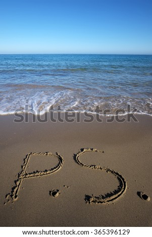 Photo closeup of word P.S. written on beautiful wet beige beach sea marine grained sand against blue waves with splashes white spindrifts running on seashore on seascape background, vertical picture - stock photo