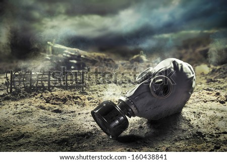 Photo Composite: Gas Mask in the aftermath of war - stock photo