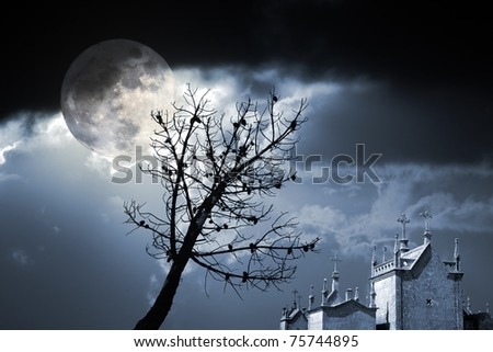 Photo composition with full moon at night, clouds, dead tree and cemetery (added some digital noise) - stock photo