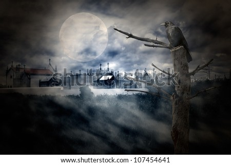 Photo composition with full moon at night, part of a naked tree, cemetery, clouds, fog and crow that can be used for halloween