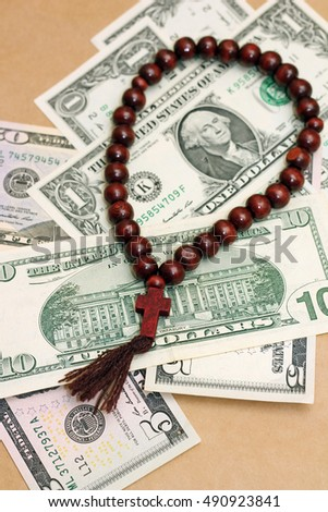 Photo concept of religion as successful business. Close-up