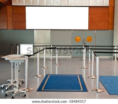 photo empty airport check in line with advert space sign - stock photo