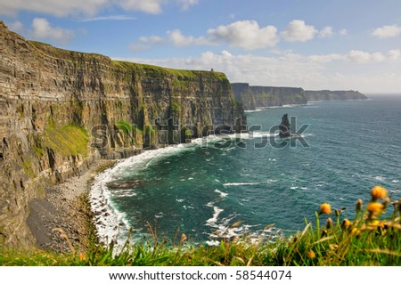photo famous cliffs of moher, castle tower, west coast of ireland. wild Atlantic way - stock photo