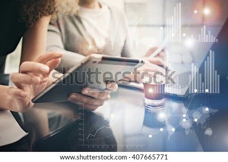Photo female hands holding modern tablet. Account managers working new private banking project office. Using electronic devices. Graphics icons, worldwide stock exchanges interface. Horizontal - stock photo