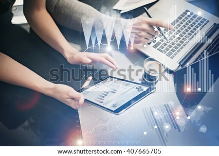 Photo female hands holding modern tablet. Risk managers working new private banking project in office. Using electronic devices. Graphics icons, worldwide stock exchanges interface. Horizontal - stock photo