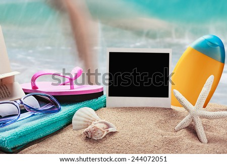 photo frame and beach gear on the sea sand - stock photo