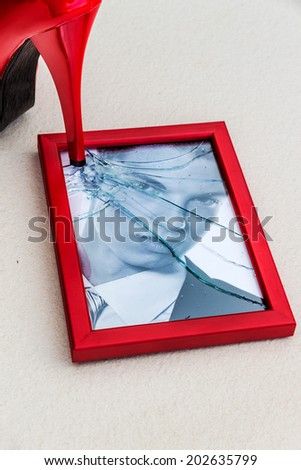 photo frame and high heels. symbolic photo for divorce, separation and relationship crisis - stock photo