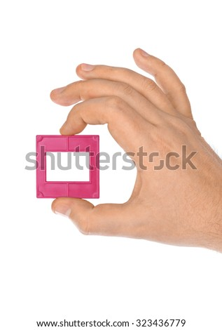 Photo frame for slide in hand isolated on white background - stock photo