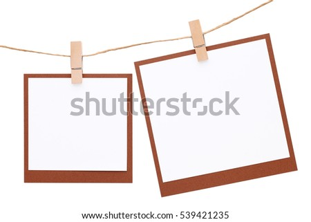 Photo frame hung on rope with clothespin isolated on white background