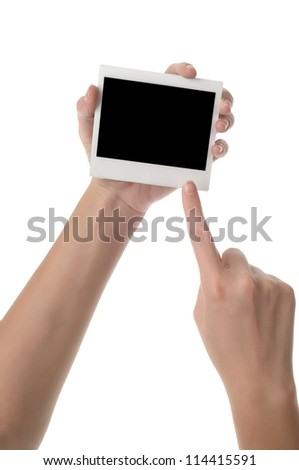 Photo frame in a hand on a white background