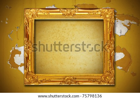 Photo frame on aged brown wall background