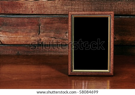 photo frame on old table - stock photo