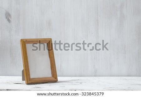 photo frame on old white table - stock photo