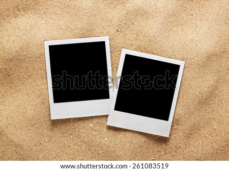 Photo frame on sand background, path inside frame - stock photo