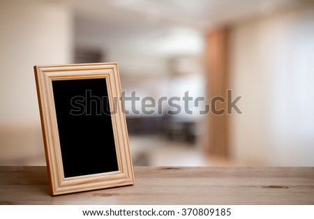 photo frame on the wooden table in the living room - stock photo
