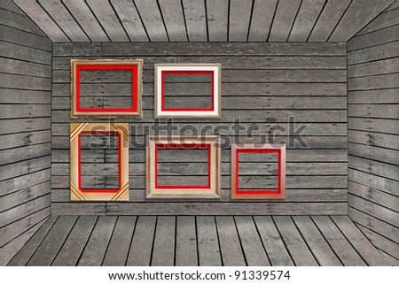 photo frame on wood wall - stock photo