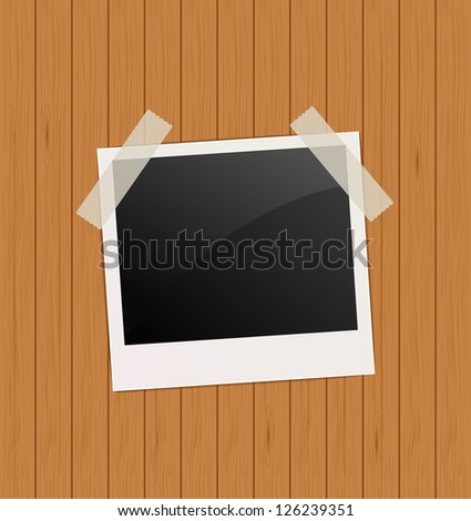 photo frame on wooden background. template for design. raster version, vector file also available in gallery - stock photo