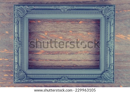 Photo frame on wooden background - vintage style effect picture - stock photo