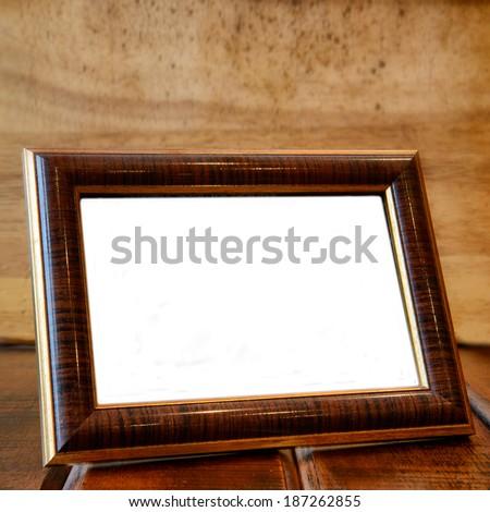 Photo frame on wooden desk - stock photo
