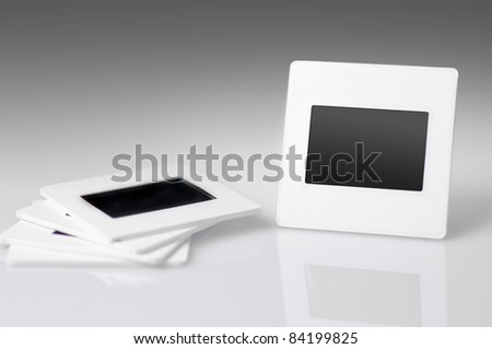 Photo frame. Slide 35mm on gray background. - stock photo