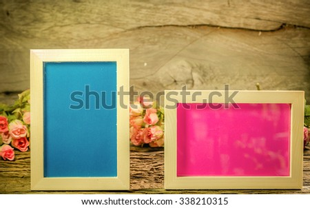 Photo frame with rose on the wooden table soft background vintage style. - stock photo