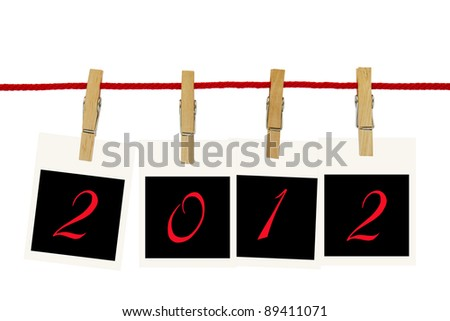 Photo frames 2012 hang by wooden peg on white background