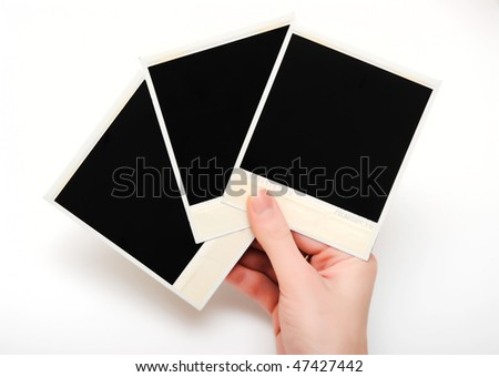 photo frames in woman's hand isolated