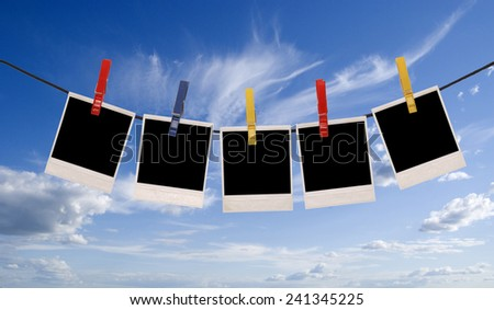 photo frames isolated over sky background - stock photo