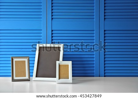Photo frames on blue folding screen background