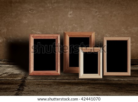 photo frames on old table - stock photo