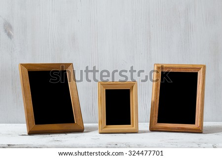 photo frames on old white table - stock photo