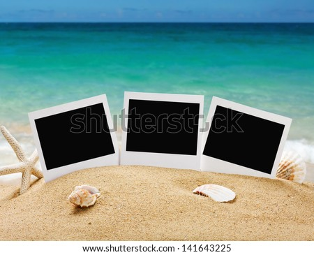 photo frames on the sea sand on the beach background - stock photo