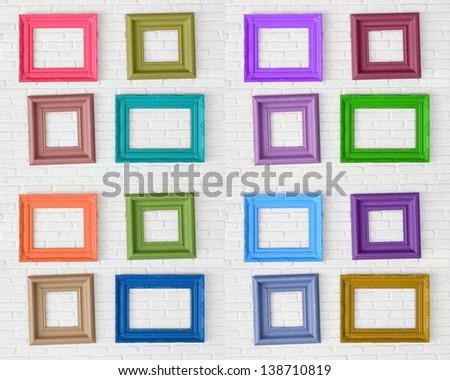 photo frames on the white wall - stock photo