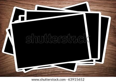 photo frames on wood background - stock photo
