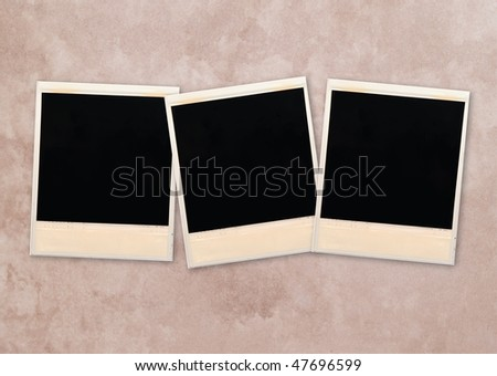 photo frames over aged paper background