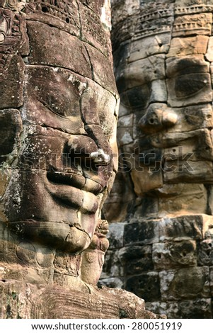 Photo from Angkor Wat world heritage site, Face at Angkor Thom or Bayon temple with near Ankor wat, Cambodia  - stock photo