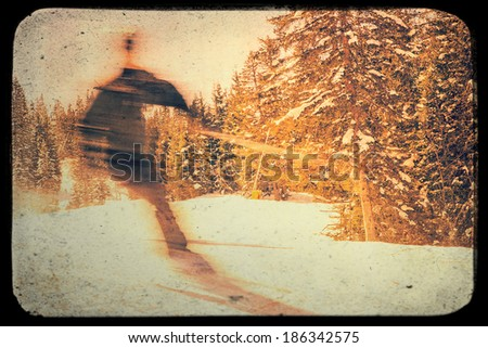 Photo from blurred skier on piste with vintage effects - stock photo