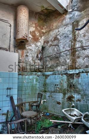 Photo from demolition  textile  factory,broken bathroom. - stock photo