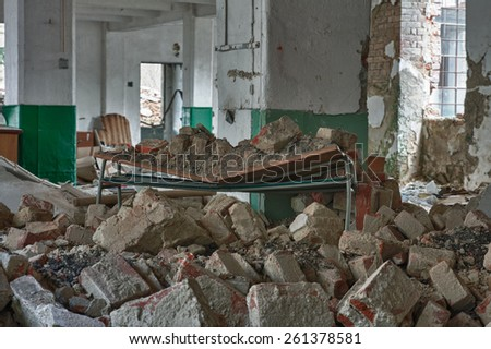 Photo from demolition  textile  factory, broken table - stock photo