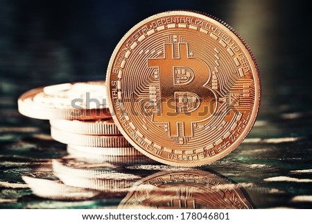 Photo Golden Bitcoins (new virtual money ) on a black background - stock photo