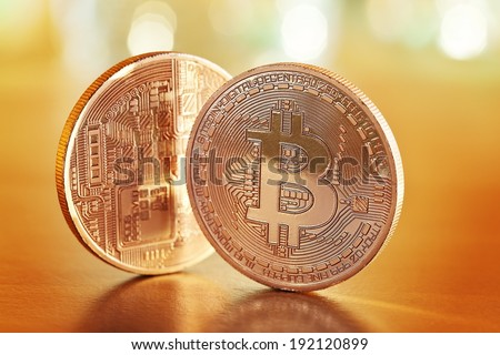 Photo .Golden Bitcoins on a gold background (new virtual money )  - stock photo