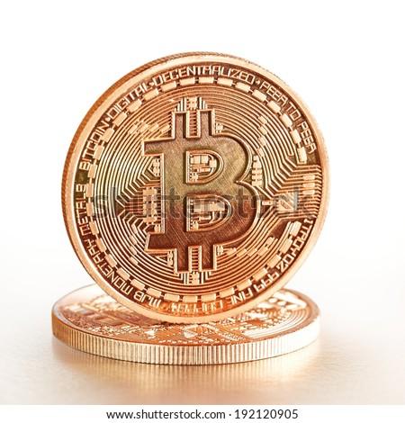 Photo .Golden Bitcoins on a white background (new virtual money ) - stock photo