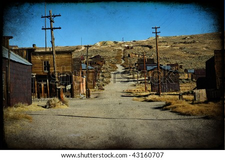 photo grunge texture of a western ghost town - stock photo
